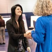 Makayla Rae Shank, left, a student at Penn State New Kensington, shakes hands with Jennifer Gilley, head librarian at the campus